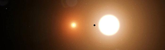 2つの星(恒星)の周りを回る惑星「TOI1338」(画像中の黒い点)(Credits: MIT / NASA)