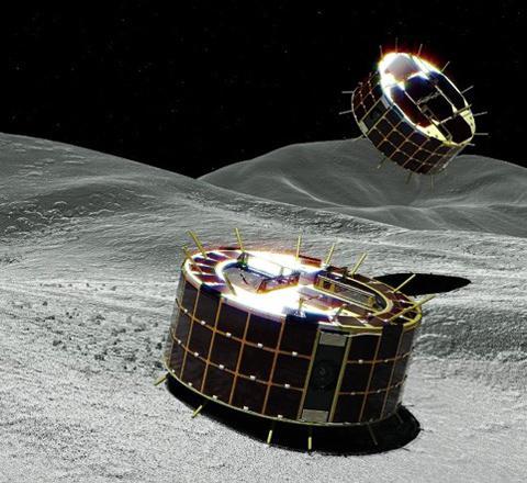 りゅうぐうの地表を探査する2台の小型探査ローバの想像図(JAXA提供)