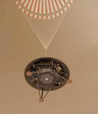 パラシュートで火星表面に降下する「インサイト」の想像図(提供・NASA / JPL-Caltech)