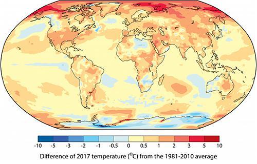 図1 世界の平均気温の2017年の値が「1981年〜2010年」平均値より高い地域が黄色や橙色で示されている(WMO提供)