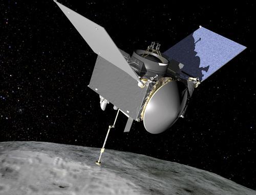 図 小惑星「ベンヌ」で試料採取中の無人探査機「オシリス・レックス」の想像図(NASA作成・提供)
