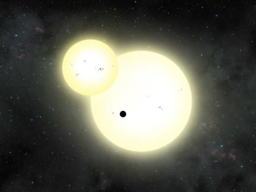 図 画家Cook氏による連星を回る惑星の想像図。小さな黒い天体が「ケプラー1647b」 (提供 NASA/Lynette Cook)