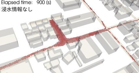 図1 地震・津波で避難する人(赤い点)の動きのシミュレーション。地震の発生から15分の時点。津波で浸水する場所の情報がなく、全員が避難所を目指したと仮定している。人が集中する場所で渋滞が起きている。(図はいずれも牧野嶋さんら研究グループ提供)