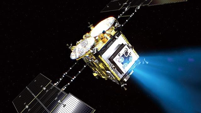 航行する小惑星探査機「はやぶさ2」の想像図(JAXA提供)
