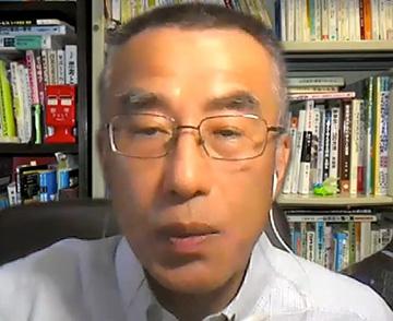 大学でZoomを使って双方向型の講義をする門倉松雄さん(提供:理科カリキュラムを考える会)
