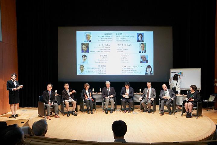 左から、司会者、駒井章治さん、小松太郎さん、マーサ・ラッセルさん、國枝秀世さん、深堀昂さん、マイケル・コールマンさん、ハンク・クネさん、ケイ・ファース・バターフィールドさん