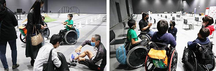 体験会では参加者がパワード車いすに試乗したり、義足を装着したりした